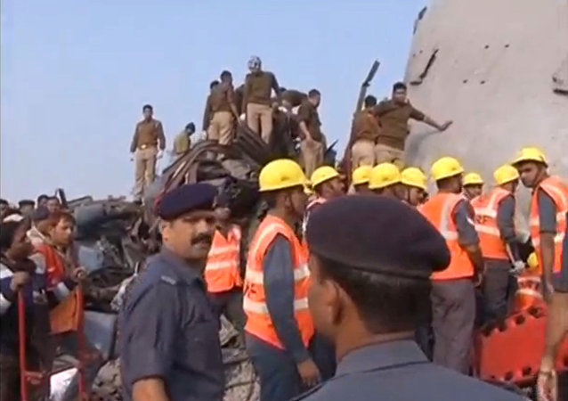 Rescuers and people gather at the site where a train derailed in Kanpur, in India's northern state of Uttar Pradesh, in this still image taken from video November 20, 2016.