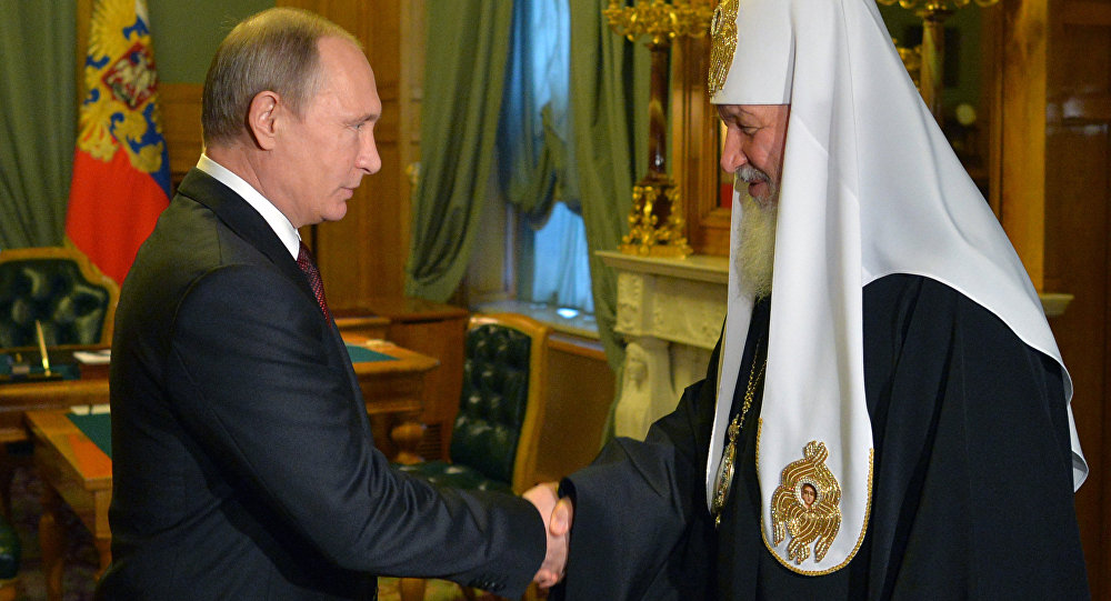 Russian President Vladimir Putin and Orthodox Patriarch Kirill during a meeting in Kremlin on November 21, 2015