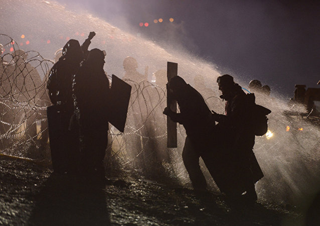 Police use a water cannon on protesters during a protest against plans to pass the Dakota Access pipeline near the Standing Rock Indian Reservation, near Cannon Ball, North Dakota, U.S. November 20, 2016.