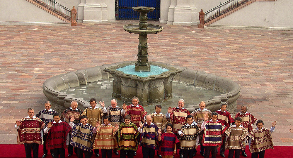 Asian-Pacific Economic Cooperation members leaders of 21 nations pose with traditional chilean ponchos for the official photograph at the Oranges Patio in La Moneda palace, in Santiago. (File)