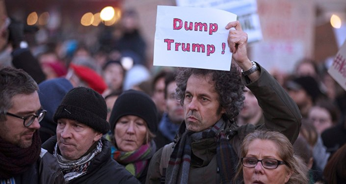People protest against US President-elect Donald Trump in Berlin, Germany, November 12, 2016.