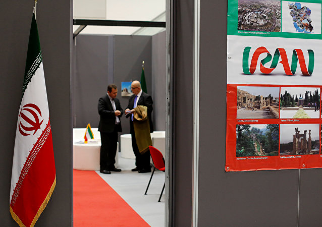 Iranian exhibitors stand in a booth during the opening of the fair Iran country presentation in Rome, Italy November 22, 2016