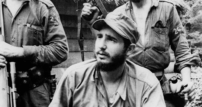 FILE - In this March 14, 1957 file photo, Fidel Castro, the young anti-Batista guerrilla leader, center, is seen with his brother Raul Castro, left, and Camilo Cienfuegos, right, while operating in the Mountains of Eastern Cuba. The man who nationalized the Cuban economy and controlled of virtually every aspect of life on the island celebrates his 90th birthday on Saturday