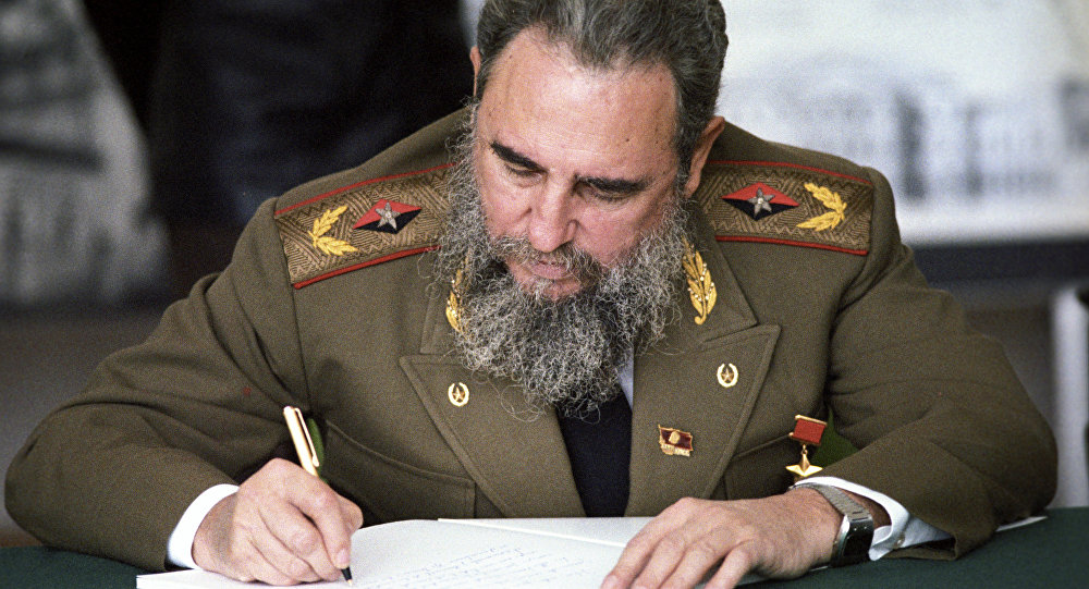 Fidel Castro, First Secretary of the Communist Party of Cuba, President of the State Council and the Council of Ministers of Cuba, head of delegation of Cuban communists at XXVII convention of CPSU making a record in the distinguished visitors' book at the main architectural and design department of Moscow