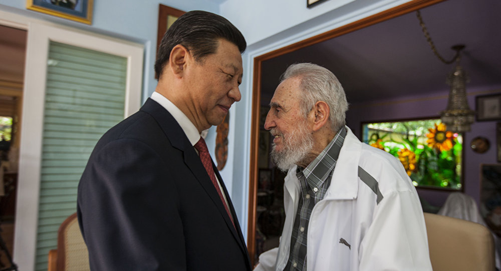 In this July 22, 2014 file photo, Cuba's Fidel Castro, right, greets China's President Xi Jinping in Havana, Cuba
