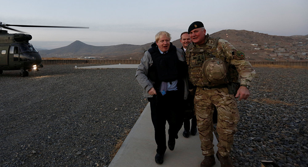 Britain's Foreign Secretary Boris Johnson (L) and Brigadier Ian Rigden, (R) Chief mentor At Afghan National Army Officer Academy arrives during his visits at Camp Qargha in Kabul, Afghanistan November 26, 2016