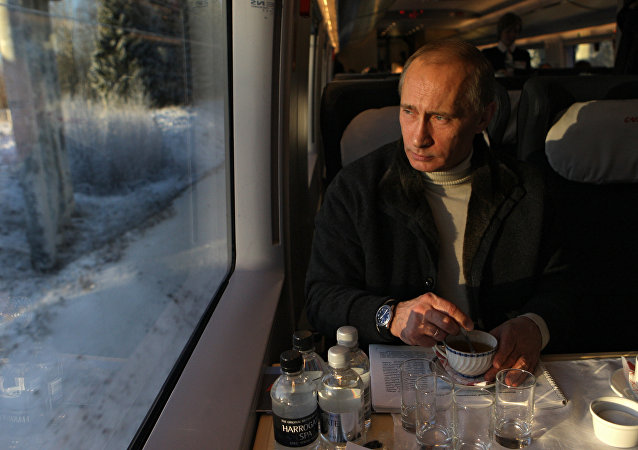 Vladimir Putin takes trip on newly launched Sapsan high-speed train