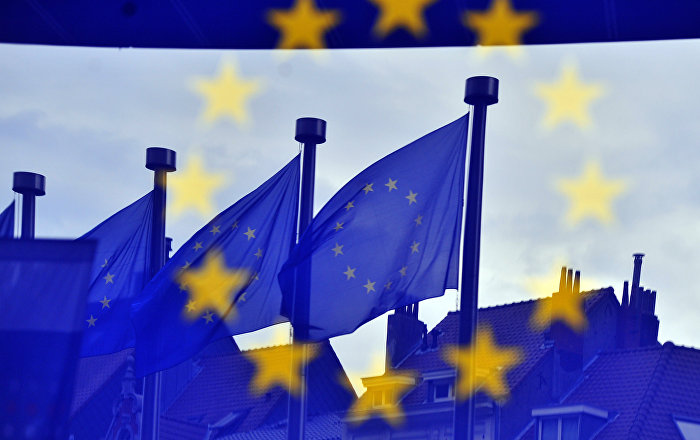 European flags are reflected at the entrance of the Berlaymont building EU Commission in Brussels