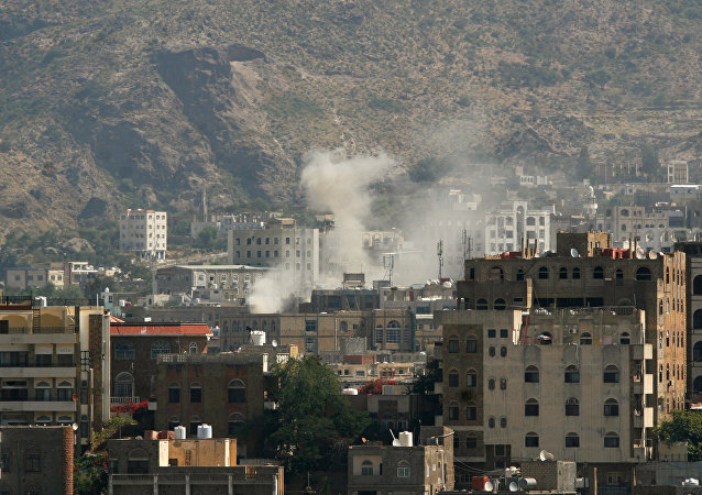 Dust rises from the site of an explosion during clashes between Houthi fighters and pro-government fighters in southwestern city of Taiz, Yemen