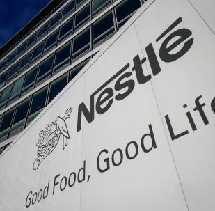 A sign of the world's biggest food company Nestle is seen at their headquarters on October 17, 2013 in Vevey