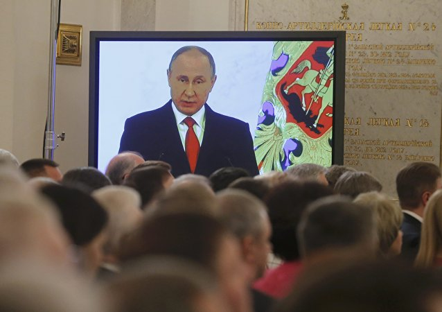 Russian President Vladimir Putin is seen on a screen during his annual state of the nation address at the Kremlin in Moscow, Russia, December 1, 2016