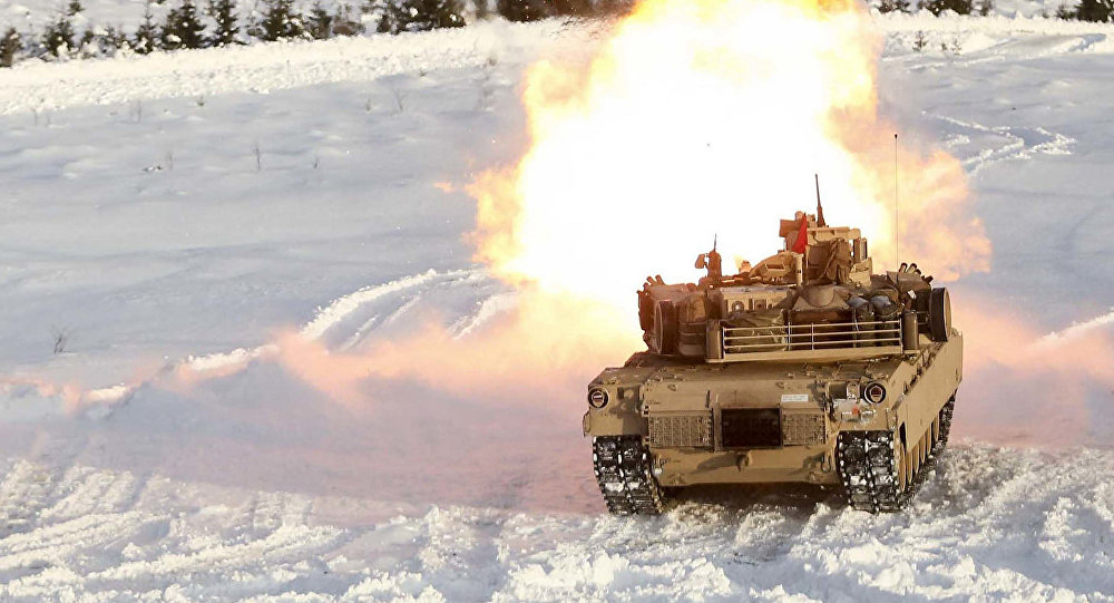 A M1A1 Abrams Tank fires its main gun as it takes part in a live-fire exercise in Rena, Norway, Feb. 18, 2016