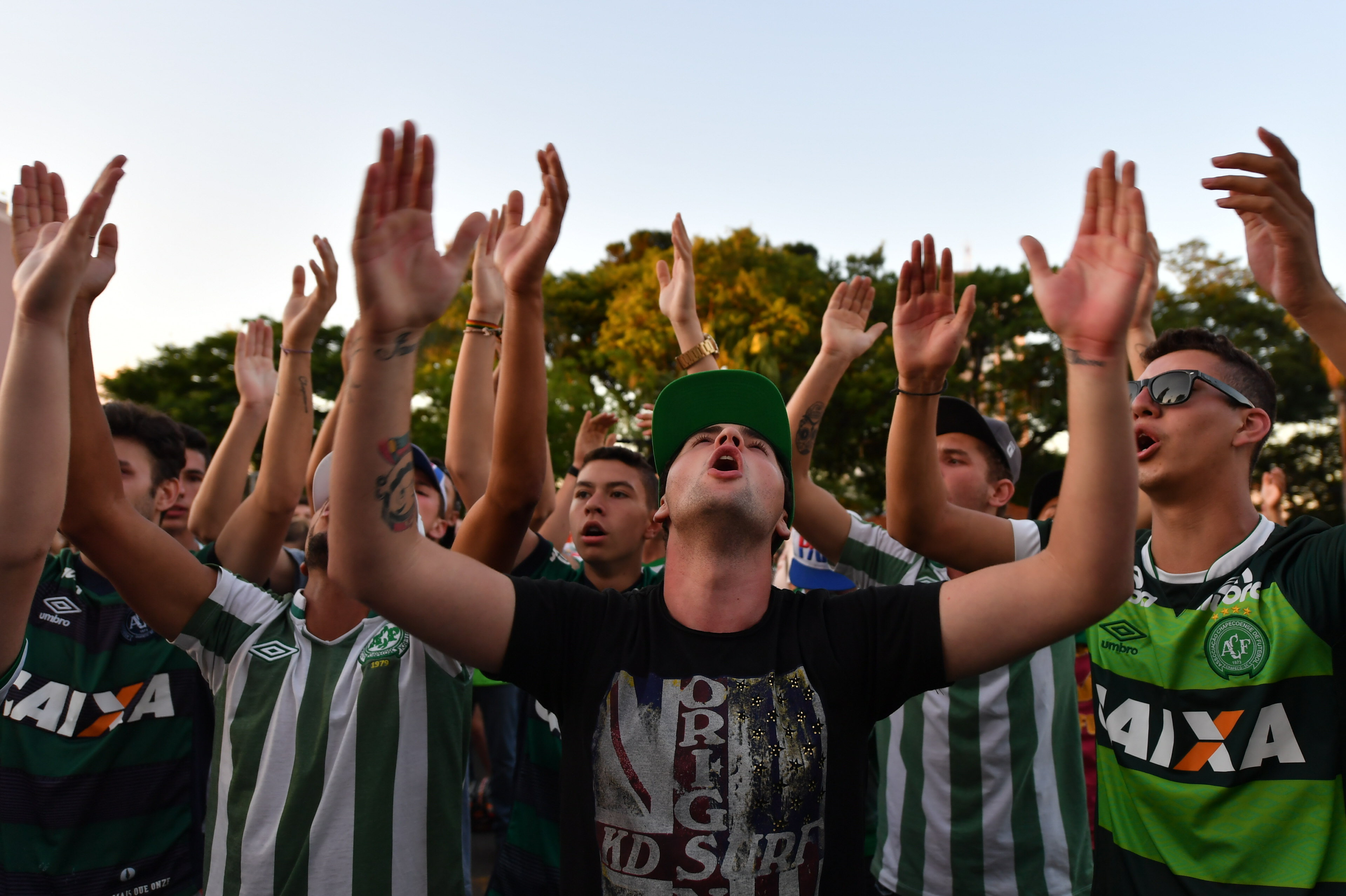 People surround a church during a mass in memoriam of the players of Brazilian team Chapecoense Real killed in a plane crash in the Colombian mountains, in Chapeco, in the southern Brazilian state of Santa Catarina, on November 29, 2016
