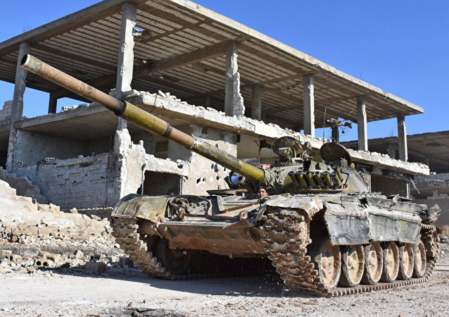 Syrian pro-government forces advance in the Myessar district in eastern Aleppo in an ongoing operation to recapture all of the battered second city, on December 4, 2016