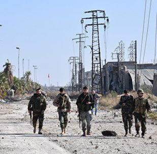 Syrian pro-government forces advance in the Myessar district in east Aleppo in an ongoing operation to recapture all of the battered second city, on December 4, 2016