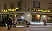 Police guards the area were three people were killed in a shooting incident at a restaurant in Imatra, Eastern Finland after midnight on December 4, 2016