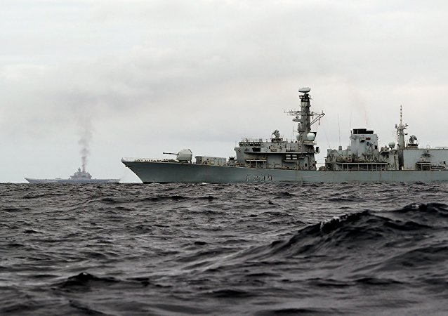This is a handout photo issued by Britain's Ministry of Defence taken on Wednesday Oct. 19, 2016, of HMS Richmond, foreground, a Type 23 Duke Class frigate, observing aircraft carrier Admiral Kuznetsov, at rear left, which is part of a Russian task group, during transit through the North Sea