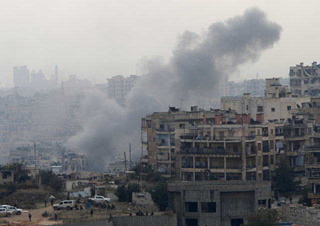 Smoke rises near Pro-Syrian government soldiers after shelling, in al-Izaa area in Aleppo, Syria December 5, 2016