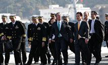 U.S. Defense Secretary Ash Carter (3rd R) and Japan's vice Minister of Defense Kenji Wakamiya (2nd R) visit the Izumo, Japan Maritime Self Defense Force's (JMSDF) helicopter carrier, at JMSDF Yokosuka base in Yokosuka, south of Tokyo, Japan, December 6, 2016.