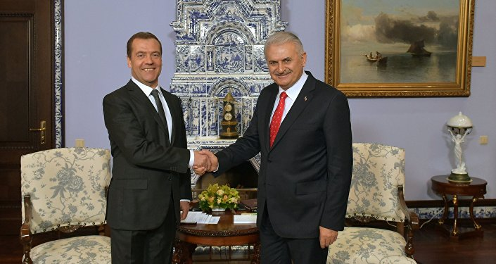 Russian Prime Minister Dmitry Medvedev and Turkish Prime Minister Binali Yildirim, right, during a meeting at Gorki residence outside Moscow