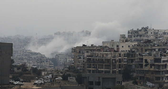 Smoke rises after rebel fighters launch a mortar shell on a residential neighborhood in western Aleppo, Syria