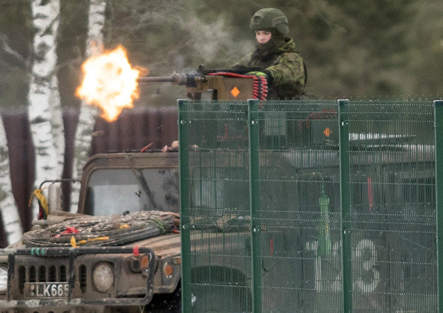 Soldiers take part in the NATO military exercise 'Iron Sword 2016' at a training range in Pabrade, north of the capital Vilnius, Lithuania on Friday, Dec. 2, 2016.