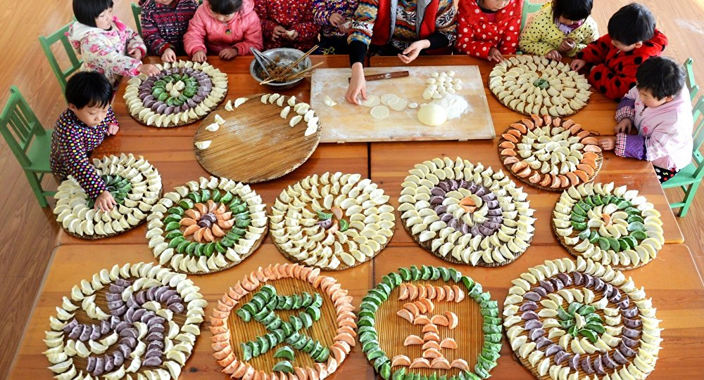Pupils display painted eggs during a folk custom activity marking lixia, the beginning of summer in Chinese lunar calendar, at a primary school in Hefei, capital of East China's Anhui province, May 5, 2016.