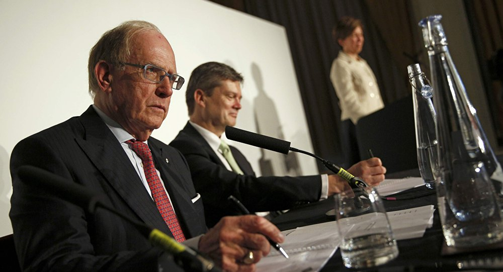 Lawyer Richard McLaren (L) takes questions after delivering his second and final part of a report for the World Anti-Doping Agency (WADA), at a news conference in London, Britain December 9, 2016