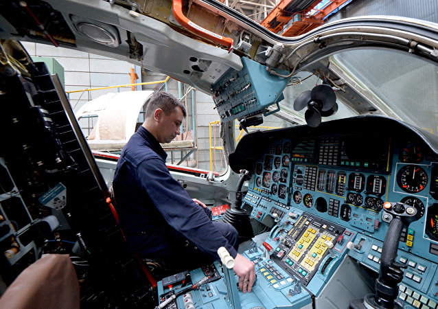 Checking electronics in the pilot cabin of a Tu-160 strategic bomber in a shop of the Gorbunov Kazan Aircraft Plant