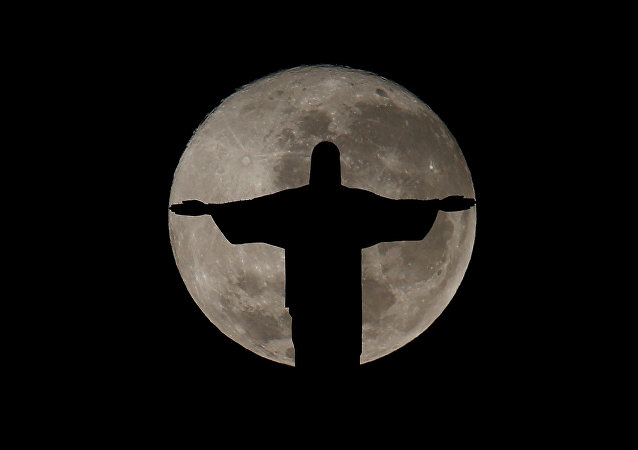The full moon is pictured behind the Christ the Redeemer statue ahead of the 2016 Rio Olympic games in Rio de Janeiro, Brazil, July 19, 2016