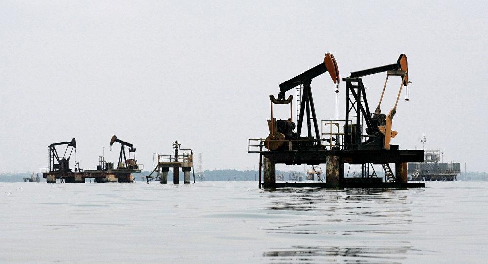 Oil pumps are seen in Lake Maracaibo, in Lagunillas, Ciudad Ojeda, in the state of Zulia, Venezuela, March 20, 2015
