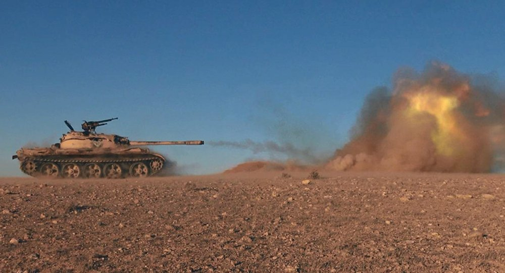 This image posted online on Dec. 10, 2016, by Daesh supporters on an anonymous photo sharing website, purports to show a tank operated by Daesh terrorists firing at Syrian troops east of Palmyra in Homs provence, Syria