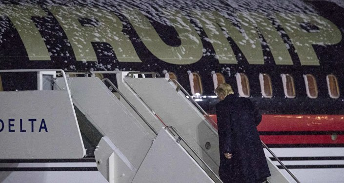 President-elect Donald Trump boards his plane at Gerald R. Ford International Airport, Friday, Dec. 9, 2016, in Grand Rapids, Mich, after attending a rally