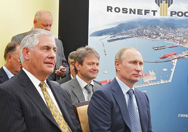 Russian President Vladimir Putin and ExxonMobil Chairman and CEO Rex Tillerson Wayne, right to left in the foreground, at the ceremony of the signing of an agreement between Rosneft and ExxonMobil on the Rosneft-Tuapse Refinery
