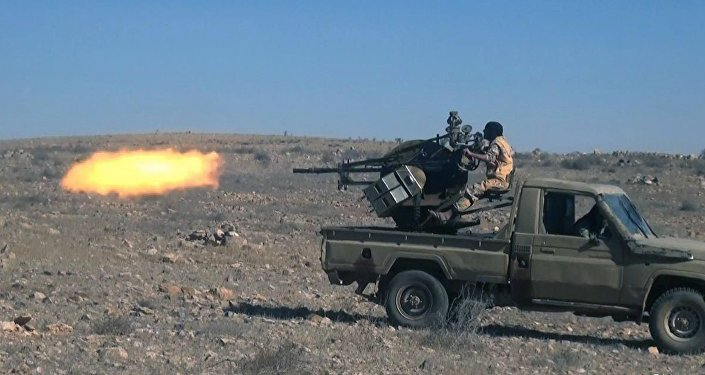 This image posted online on Saturday, Dec. 10, 2016, by supporters of the Daesh militant group on an anonymous photo sharing website, purports to show a gun-mounted vehicle operated by the group firing at Syrian troops, north of Palmyra city, in Homs Provence, Syria
