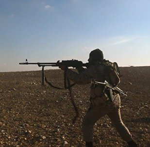 This image posted online on Saturday, Dec. 10, 2016, by supporters of the Islamic State militant group on an anonymous photo sharing website, purports to show a gunman firing at an unseen target, east of of Palmyra, east of Palmyra city, in Homs provence, Syria