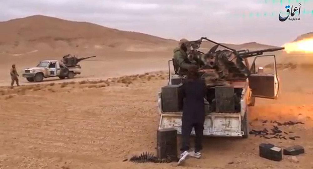 A still image taken on December 11, 2016 from a video released by Islamic State-affiliated Amaq news agency on December 10, 2016, purports to show Islamic State fighters advancing over the Hayan mountain south of Palmyra