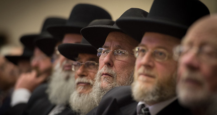 Rabbis and members of the Orthodox Jewish community attend the Installation of Chief Rabbi Ephraim Mirvis as the 11th Chief Rabbi of the United Hebrew Congregations of the UK and the Commonwealth during a ceremony at the St John's Wood Synagogue in north London on Spetember 1 2013.