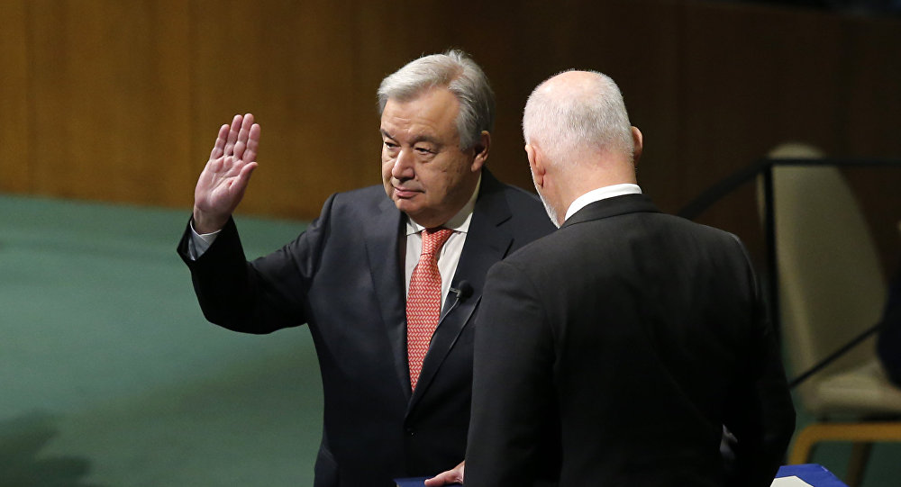 Antonio Guterres (L) is sworn in as UN secretary general during the Oath of office of the Secretary-General December 12, 2016 at the United Nations in New York