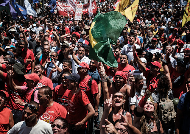 Protesters shout slogans during a public servants' demonstration against austerity measures in front of the Rio de Janeiro state Assembly (ALERJ), in Rio de Janeiro, Brazil, on December 12, 2016