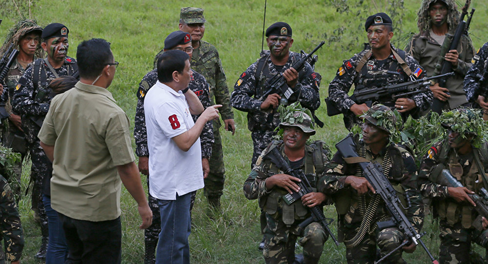 Philippine President Rodrigo Duterte talks to the Philippine Army Scout Rangers at their headquarters at Camp Tecson in San Miguel township, north of Manila, Philippines Thursday, Sept. 15, 2016