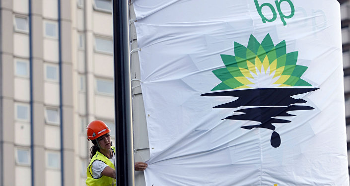 In this Tuesday, July 27, 2010, file photo, a Greenpeace activist puts up a banner as they block off a British Petroleum fuel station in protest as the BP board announce their annual results, in London