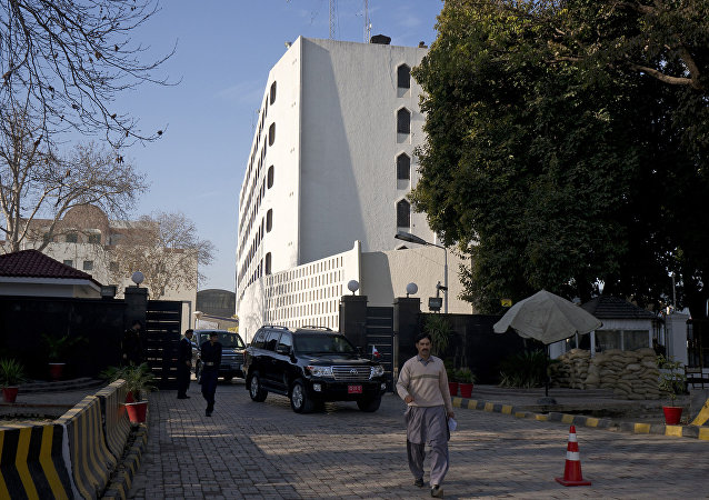 Cars leave the Foreign Ministry building, a venue of peace talks in Islamabad, Pakistan.