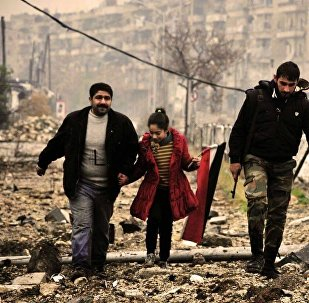 Civilians helped by Syrian Army in Aleppo