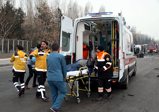 A wounded man is carried to an ambulance after a bus was hit by an explosion in Kayseri, Turkey, December 17, 2016.