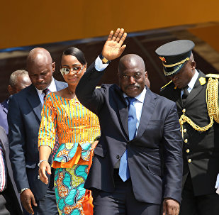 Congolese President Joseph Kabila, center, waves as he and others celebrate the Democratic Republic of Congo, DRC, independence in Kindu, Congo, Thursday, June 30, 2016. Congo's president says nothing can stop long-awaited elections from taking place even as fears mount of a possible delay.