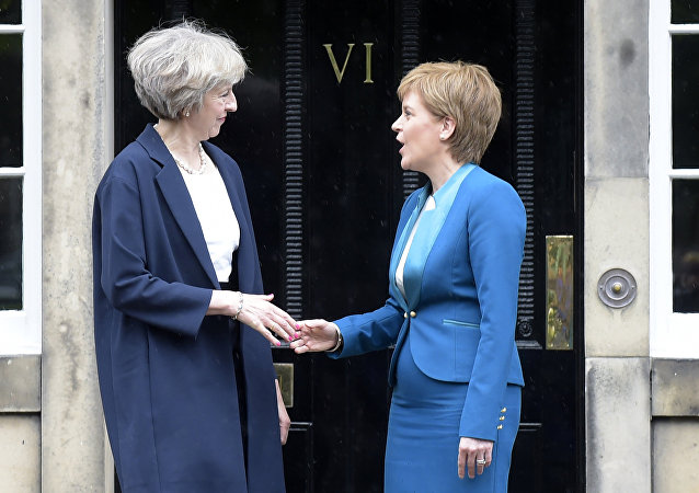 Britain's Prime Minister Theresa May (L) is greeted by Scotland's First Minister Nicola Sturgeon (R) as she arrives for talks at Bute House, in Edinburgh, on July 15, 2016.