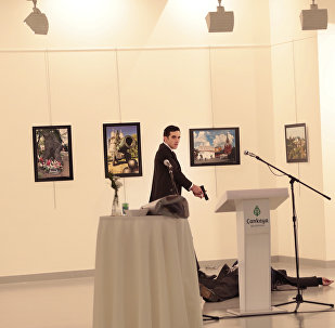 Altintas gestures after shooting the Russian Ambassador to Turkey, Andrei Karlov, at a photo gallery in Ankara, Turkey.