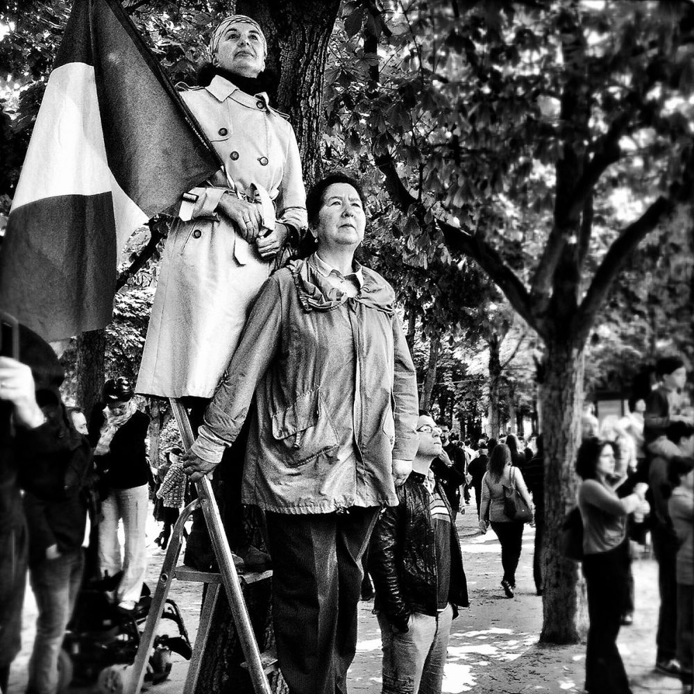 Two women waiting for the 14th July parade on the Champs Elysées (Paris, France) by Marina Spironetti, Italy.