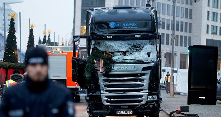 Police stand in front of the truck which ploughed into a crowded Christmas market in the German capital last night in Berlin, Germany, December 20, 2016.